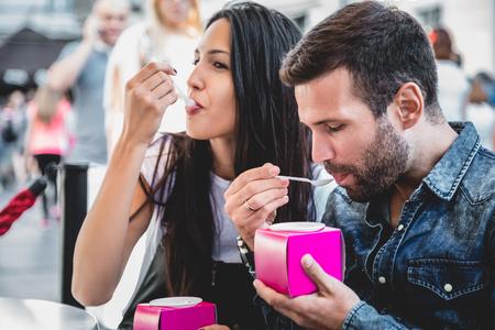 eating ice cream: Couple eating ice cream in the city Stock Photo