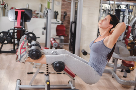 girl working out: Girl working out abs in te gym Stock Photo