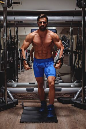 crossover: Man working out chest on cable crossover Stock Photo