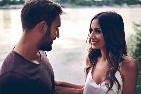 boyfriend: Girl is looking at her boyfriend with love. Evening scene