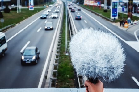 microphones: Sound engineer recording highway sound from the bridge