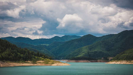 Zaovine lake with beautiful turquoise water, mountains and summer cloudy sky Standard-Bild
