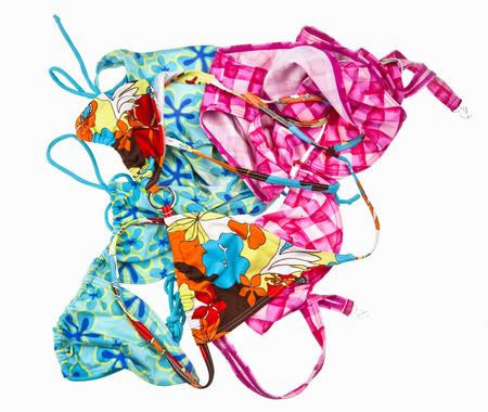 personas banandose: Pequeño montón de trajes de baño aislado