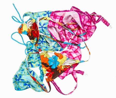 swim suit: Small pile of swim suits isolated Stock Photo