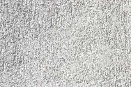stucco facade: Bianca facciata trama grezzi in stucco primo piano