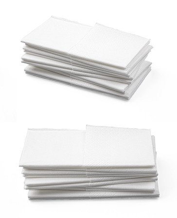 hankie: Stack of folded disposable paper tissues on white background