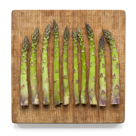 Asparagus on bamboo cutting board photo