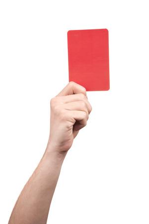 arbitro: Árbitro del fútbol la mano que sostiene la tarjeta roja