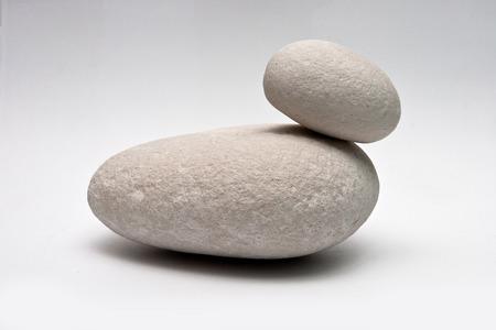 Decorative stone stack isolated on white studio background  macro shot shallow depth of field photo