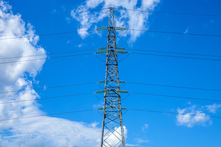 powerlines: Electrical powerlines and blue sky with clouds