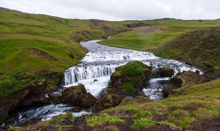 skogafoss waterfall: Iceland, Skogafoss waterfall in a rainy summer day Stock Photo