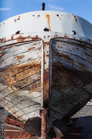 old boat hull in dry dock