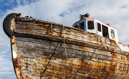 depraved: old boat hull in dry dock