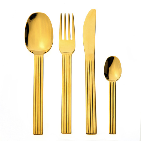 Gold cutlery isolated on white background Stock Photo - 57929354