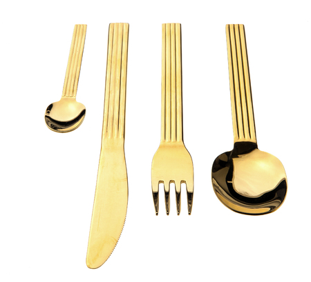 Gold cutlery isolated on white background Stock Photo
