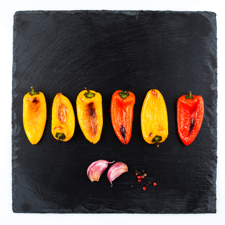 Red and yellow peppers grilled on olive oil Stock Photo - 58036449