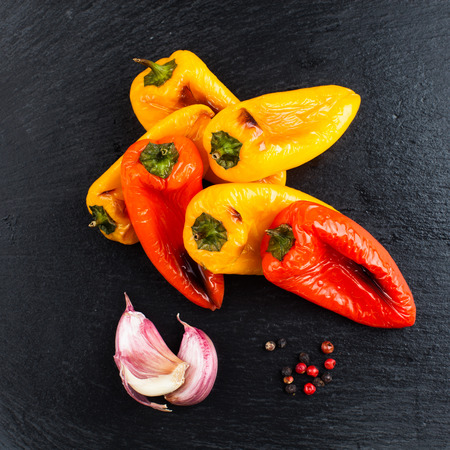 Red and yellow peppers grilled on olive oil Stock Photo - 58036446