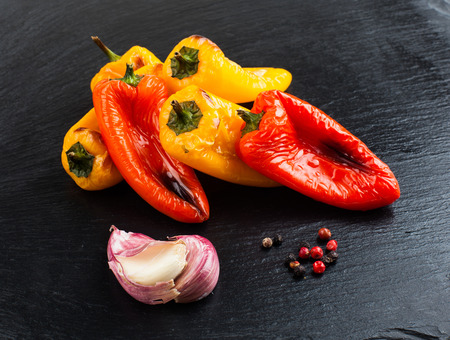 Red and yellow peppers grilled on olive oil Stock Photo - 58036450