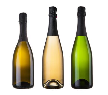 tres botellas de champán en blanco Foto de archivo