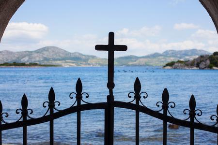 Cross on a fence door, mediterranean church, Croatia