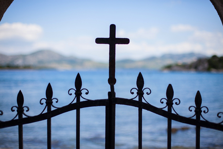 Cross on a fence door, mediterranean church, Croatia Stock Photo - 122981064
