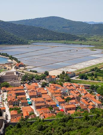 Slat pans in Ston town, Croatia. Stock Photo - 120142253