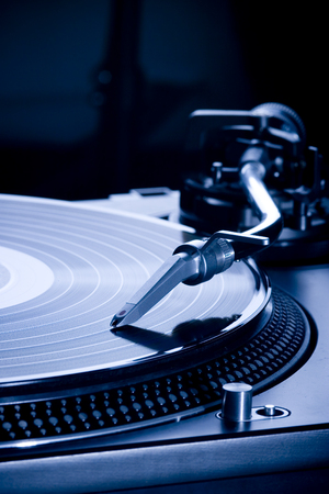 Record player playing LP in dark room, macro picture Stock Photo - 120142008