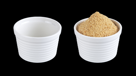 Two bowls one empty the other with ground biscuits