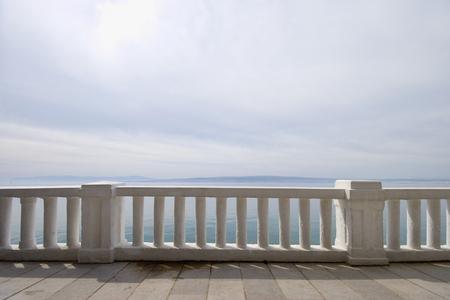 Promenade path near the mediterranean sea, concrete fence - off season Stock Photo - 122981069