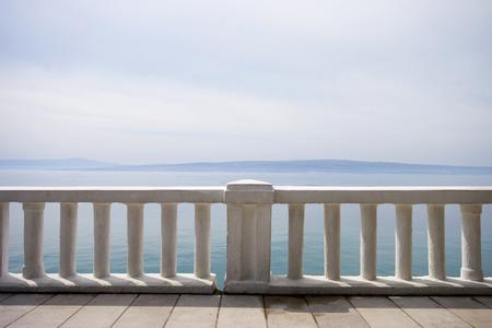 Promenade path near the mediterranean sea, concrete fence - off season
