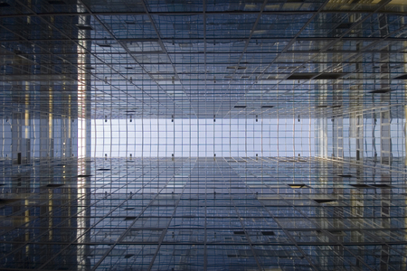 Perspective and underside angle abstract view to textured background of modern glass office building