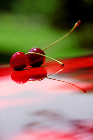 Close up of fresh cherry berries photographed in daylight conditions Reklamní fotografie
