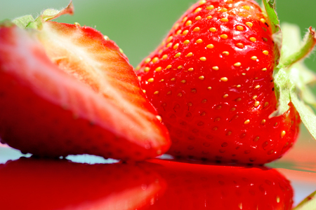 Fresh strawberry photographed in daylight conditions