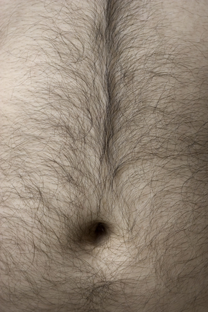 Detail of mans body - belly with hair