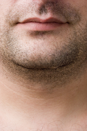 CLose-up of a mans mouth and chin