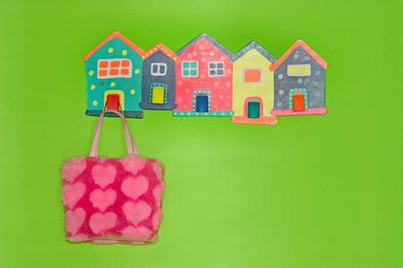 Bag for children on hanger in a green room