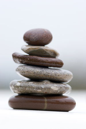 Stack of wet river stones in a balance