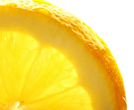 Lemon slice with a water droppings. Macro studio shot