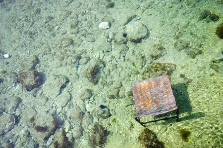 Stray chair under the sea
