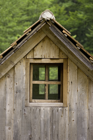Old wooden cottage roof and window Stock Photo - 121562902