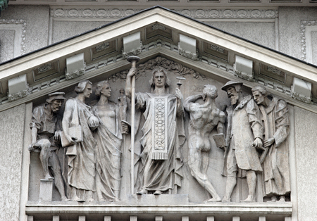 Human figures on a classical facade decoration
