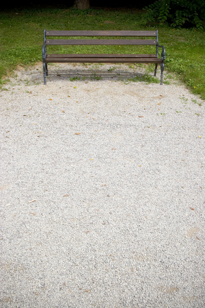 bench in a park, gravel path and grass Stock Photo - 121562815