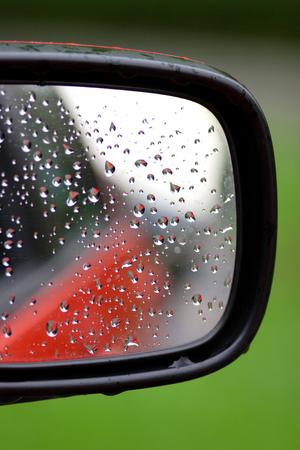 Blurred, Rain drops on a car rear mirror Stock Photo