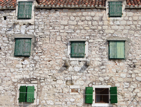 Facade of old traditional mediterranean stone house