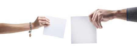 Hands holding, delivering blank piece of paper Stock Photo - 121562761