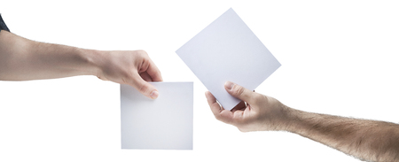 Hands holding, delivering blank piece of paper Stock Photo - 121562691