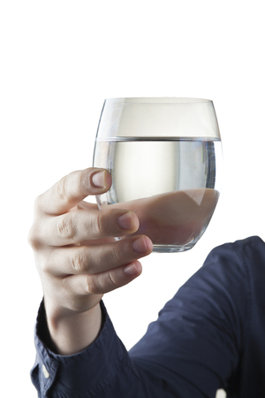 Male hand holding clear glass of water Stock Photo - 121562706