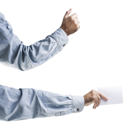 Hands holding, delivering blank piece of paper Stock Photo