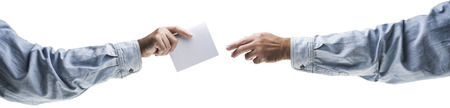 Hands holding, delivering blank piece of paper Stock Photo - 121562716