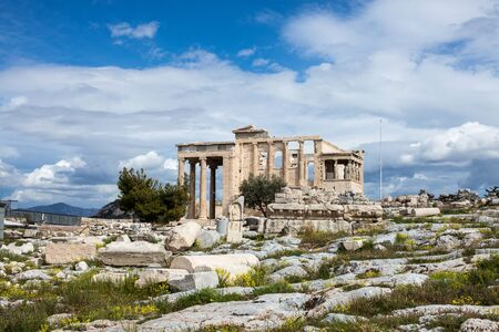 The ancient Erechtheion temple with the Caryatid pillars on the porch, on the Acropolis in Athens.
